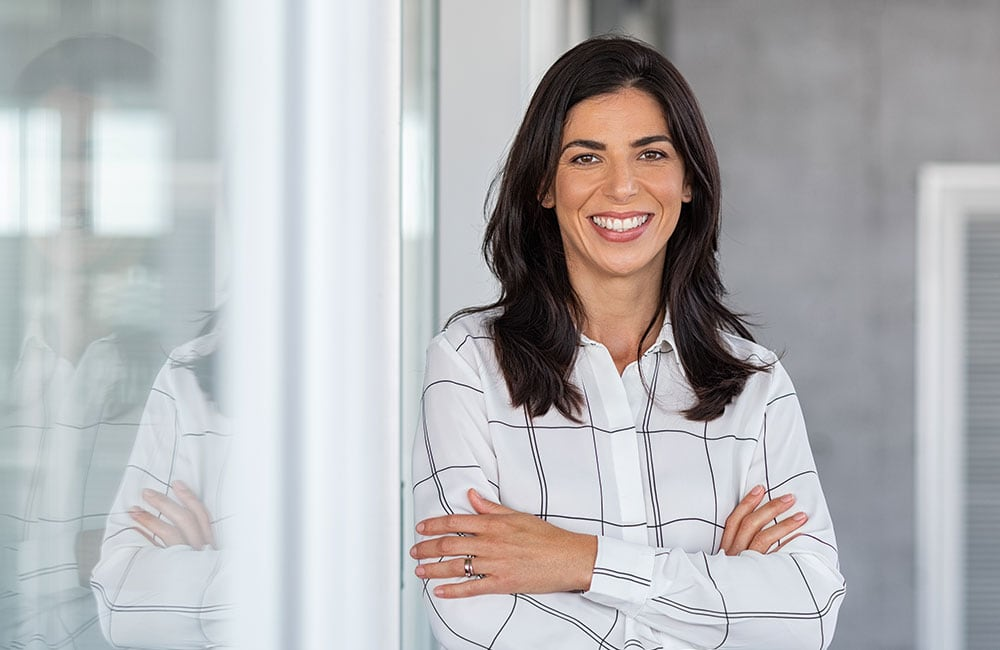 Business woman smiling after getting job